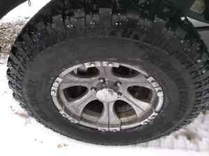 """4 35"""" tires and aftermarket rims"""