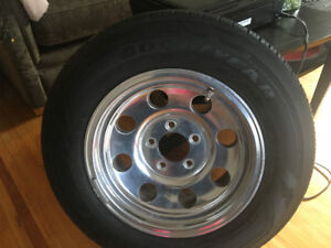 Almost new Goodyear Assurance (4) tires & rims for $600.