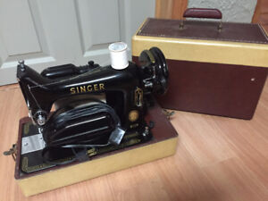 1955 Singer portable sewing machine with attachments