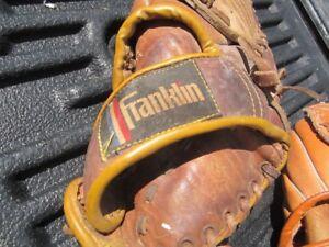2  older  base ball gloves  plus ball