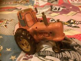 Disney cars pull lightening mc queen into the sleeping tractor