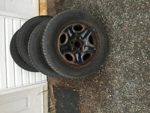 Four tires and rims for Ford minivan