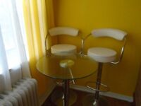 For Sale two-bar stool, small bar tables, and a beautiful glass!