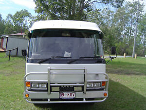Toyota Coaster Deluxe motorhome LWB Petrie Pine Rivers Area Preview
