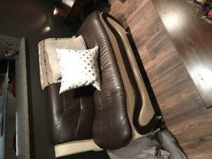 Brown faux leather couch, love seat and chair