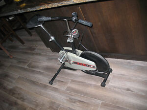Compact stand alone exercise bike