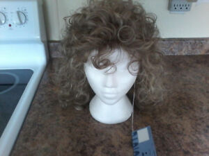 brand new tags on color 18/22 size average long curly wig