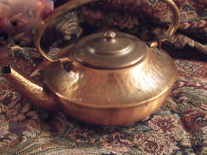 One was Hammered  the other not…. vintage copper  teapots