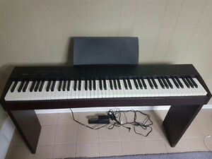 Roland F-20 digital piano with stand