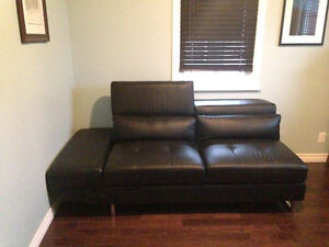Like new modern black leather sectional couch