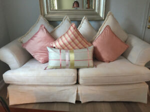 Lovely off white couch with silk accent cushions