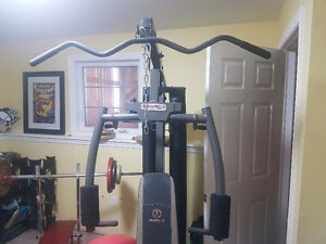 Unersival Workout machine/Spin bike/ Rack 4 dumbells.