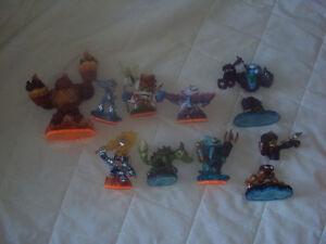 Skylander figurines and two Portal figurines