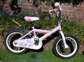 16 inch wheels girls pink bike with helmet.