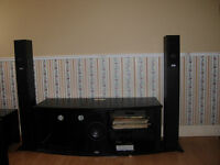 Tv stereo stand with tower speakers.