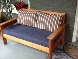 Two seater couch, with pine frame .$25.00