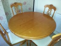 Table and 4 upholstered chairs
