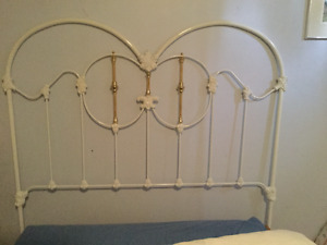 Wrought iron headboard with brass accents