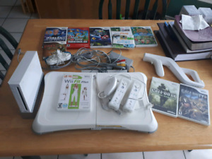 Wii with remotes, accessories and games!