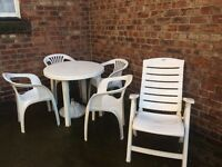 Garden table and four chairs with recliner