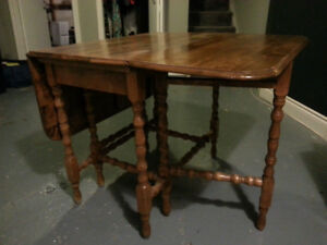 Solid wood folding gate-leg table - $70
