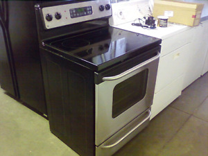 Ge glass top electric range black and stainless