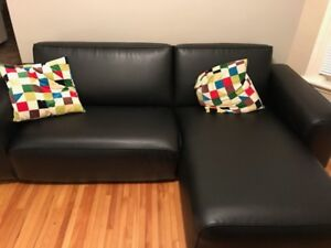 Black two piece pleather sectional