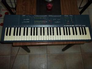 clavier bontempi az 9000 stereo midi synth avec 2 pied.