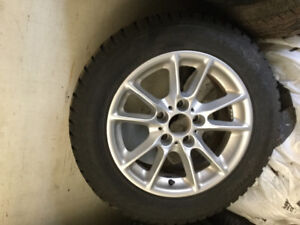 225/55/16 Hankook Ipike new studded tires on BMW Alloys