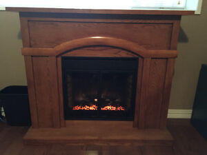 Oak fireplace with electric heater