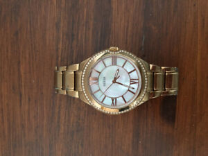 Beautiful guess watch with mother of pearl face