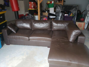 Leather coach with chaise and pull out bed