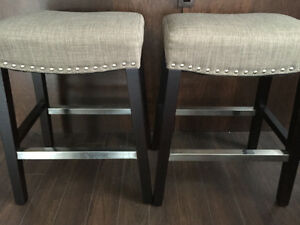 Two studded fabric and wood counter stools - like new