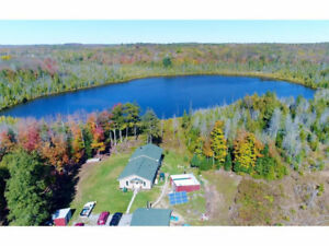 100 ACRES OF HARDWOOD WITH LAKE ,HOME AND GARAGE