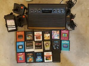 Atari 2600 + all hook ups, 3 controllers and 17 games