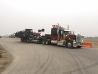 need equipment hauled? we can help! we also tow drills!