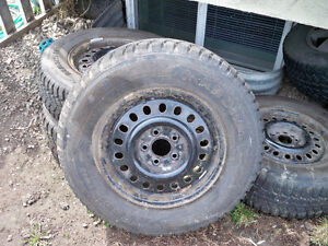 "as new 15"" studded winter tires on rims 215/70r/15, 5 bolt ford"