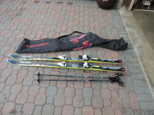 Solomon Skis, poles and carrying bag