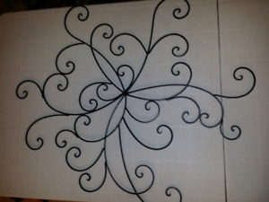 Metal scrollwork wall hanging