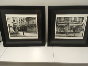 Two black and white framed pictures
