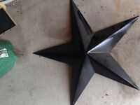 Black metal star home decor inside outside