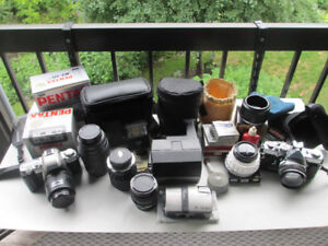 assortment of cameras, Pentax, Olympus, and stuff
