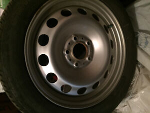 REDUCED!!! studded snow tires with silvertone steel rims