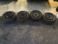 4 Goodyear Nordic winter tires & steal rims