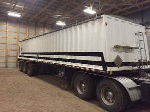 Tri-axle grain trailer.