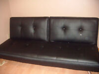 Black leather fold down couch bed