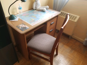 rectangular brown wooden table with a chair