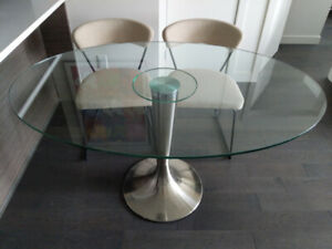 Oval tempered clear glass dining table