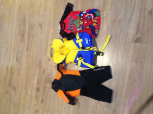 Child's size 4 wetsuit, lifejacket, and rash guard