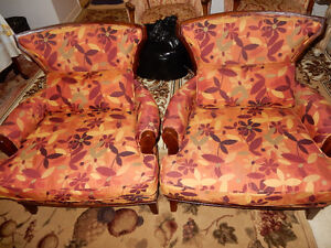 2 Designer arm Chairs with stain resistant fabric.